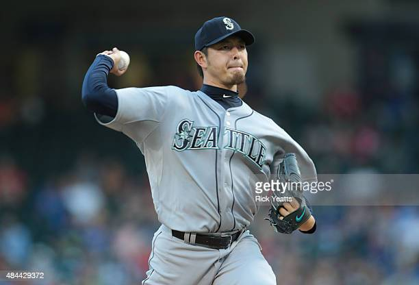 Hisashi Iwakuma of the Seattle Mariners throws in the first inning against the Texas Rangers at Global Life Park in Arlington on August 18 2015 in...