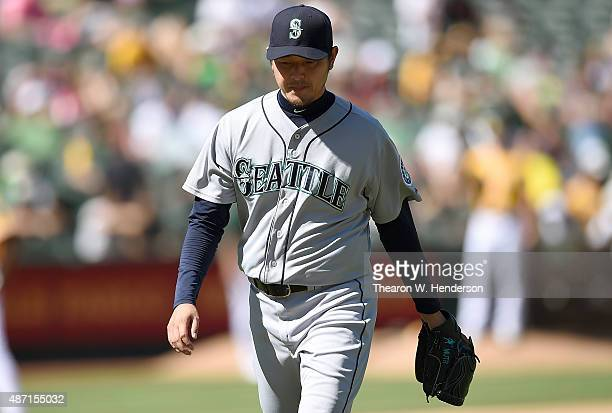 Hisashi Iwakuma of the Seattle Mariners walks back to the dugout after he was taken out of the game against the Oakland Athletics in the bottom of...