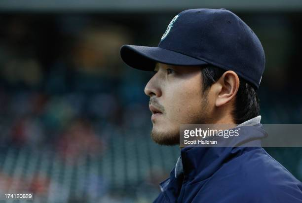 Hisashi Iwakuma of the Seattle Mariners walks to the bullpen before his start against the Houston Astros at Minute Maid Park on July 20 2013 in...