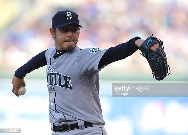 Hisashi Iwakuma of the Seattle Mariners warms up in the first innings during a game against the Kansas City Royals at Kauffman Stadium on June 20...