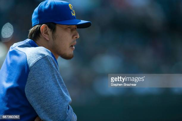 Hisashi Iwakuma of the Seattle Mariners watches play from the dugout during a game against the Chicago White Sox at Safeco Field on May 21 2017 in...