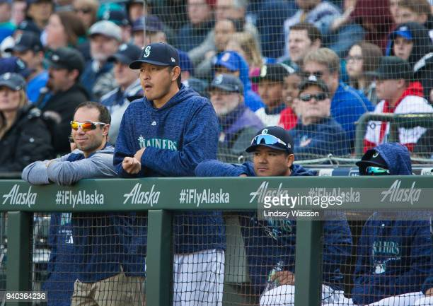 Hisashi Iwakuma of the Seattle Mariners watches the game against the Cleveland Indians at Safeco Field on March 31 2018 in Seattle Washington