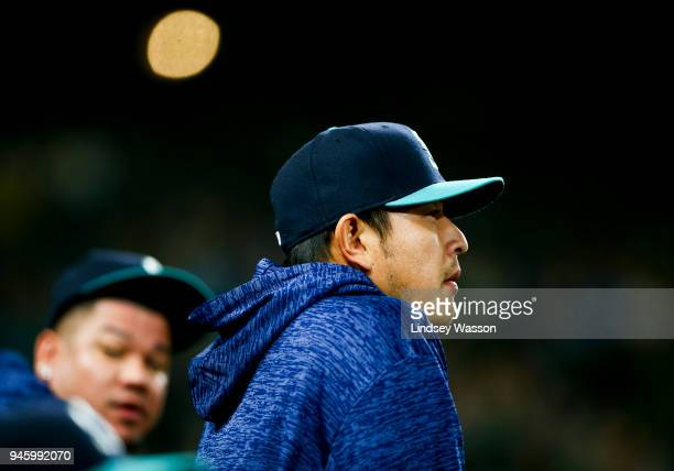 Hisashi Iwakuma of the Seattle Mariners watches the game from the dugout in the first inning against the Oakland Athletics at Safeco Field on April...