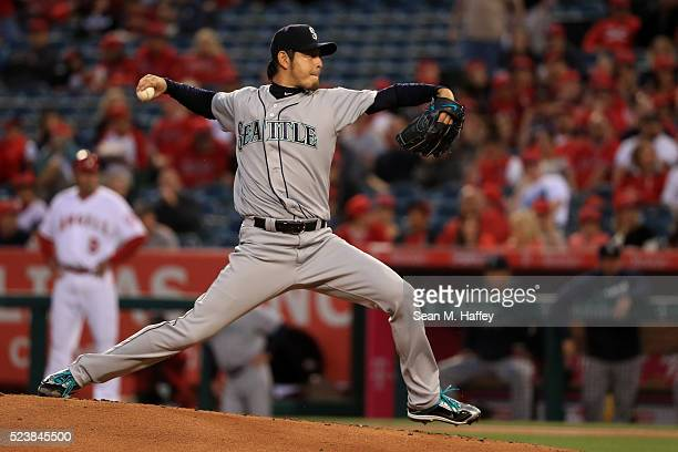 Hisashi Iwakuma of the the Seattle Mariners pitches during the first inning of a baseball game between the Los Angeles Angels of Anaheim and the...
