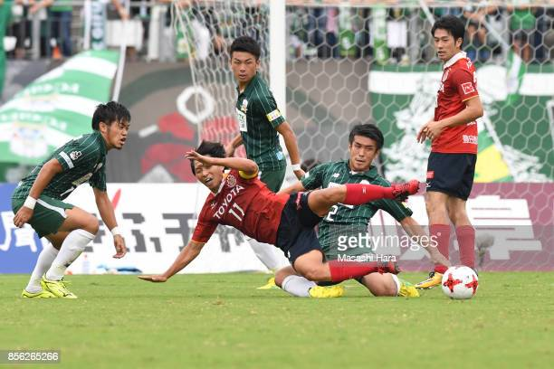 Hisato Sato of Nagoya Grampus and Masanori Abe of FC Gifu compete for the ball during the JLeague J2 match between FC GIfu and Nagoya Grampus at...