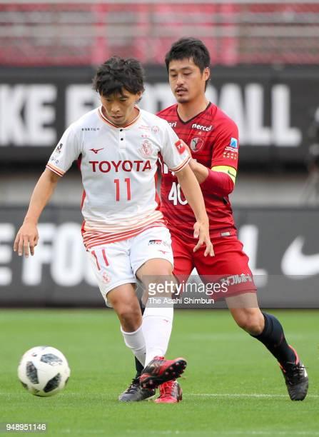 Hisato Sato of Nagoya Grampus controls the ball under pressure of Mitsuo Ogasawara of Kashima Antlers during the JLeague J1 match between Kashima...