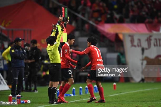 Hisato Sato of Nagoya Grampus is replaced by Keiji Tamada during the J.League J1 Promotion Play-Off Final between Nagoya Grampus and Avispa Fukuoka...