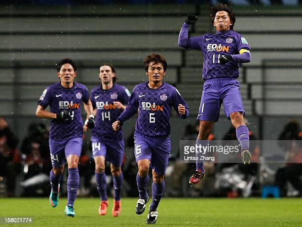 Hisato Sato of Sanfrecce Hiroshima celebrates his first goal with his team mate during the FIFA Club World Cup Quarter Final match between Sanfrecce...
