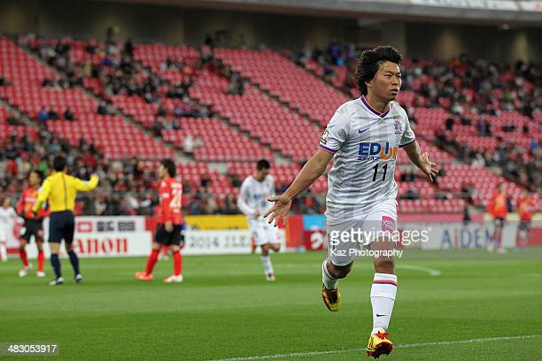 Hisato Sato of Sanfrecce Hiroshima celebrates scoring his team's first goal during the J. League match between Nagoya Grampus and Sanfrecce Hiroshima...