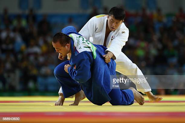 Hisayoshi Harasawa of Japan competes against Abdullo Tangriev of Uzbekistan during the Men's 100kg Judo contest on Day 7 of the Rio 2016 Olympic...