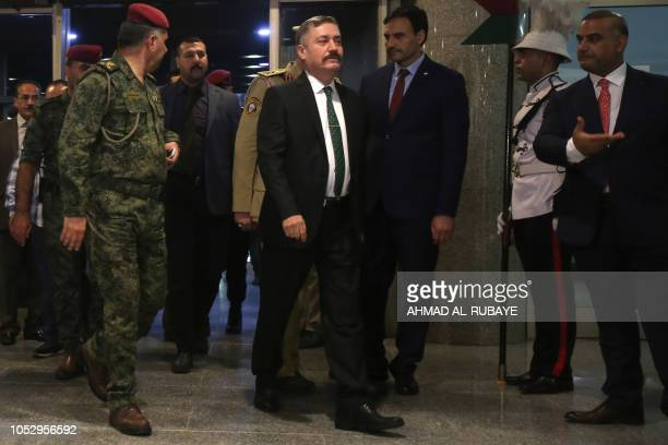 Hisham Darraji candidate ot the ministry of Defense arrives at parliament headquarters in the capital Baghdad on October 24 prior to a vote on the...