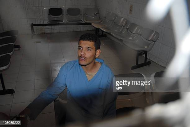 Hisham Mohammed Assem a Yemeni accused of killing a Frenchman sits behind the bars at the start of a court hearing in Sanaa on January 17 during...