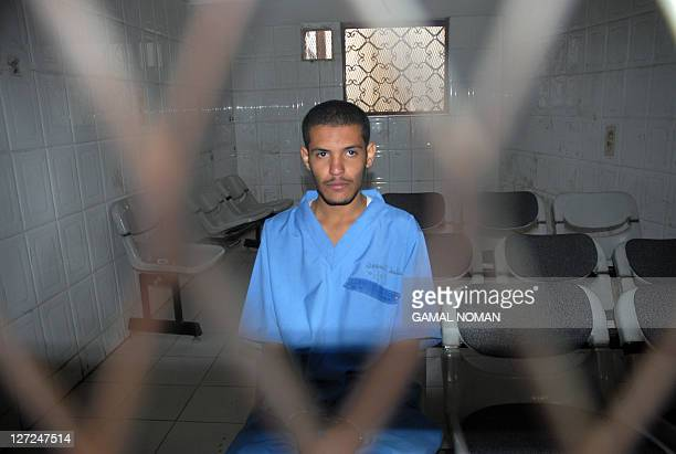 Hisham Mohammed Assem accused of killing French energy contractor Jacques Spagnolo near Sanna last month sits behind the bars during his trial at a...