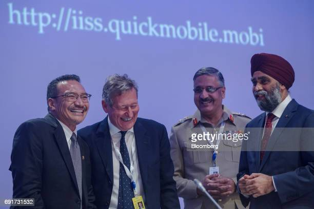 Hishammuddin Hussein Malaysia's defense minister from left John Chipman chief executive and director general of International Institute for Strategic...