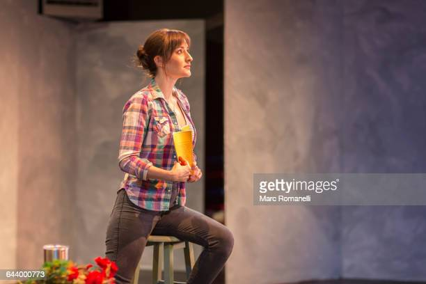 hispanic actress rehearsing on theater stage - actor stockfoto's en -beelden