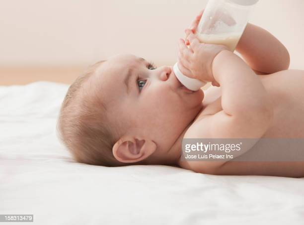 Hispanic baby drinking from bottle