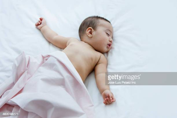 hispanic baby sleeping on bed - bare breasted babes stock pictures, royalty-free photos & images