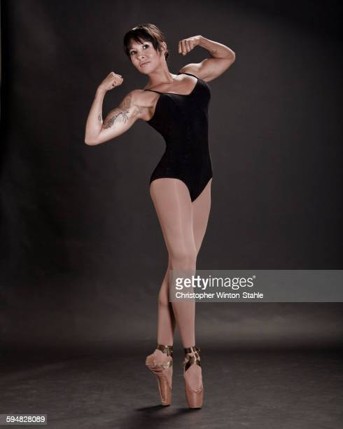 Hispanic ballet dancer flexing muscles