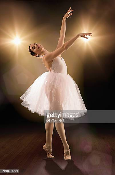 Hispanic ballet dancer performing on stage