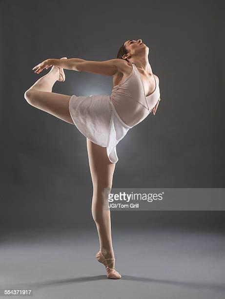 Hispanic ballet dancer posing on tip toe