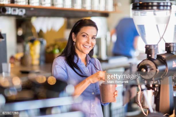 hispanic barista making coffee in cafe - zakelijke kleding stock pictures, royalty-free photos & images