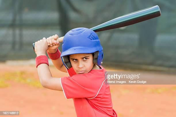 Hispanic baseball player about to swing