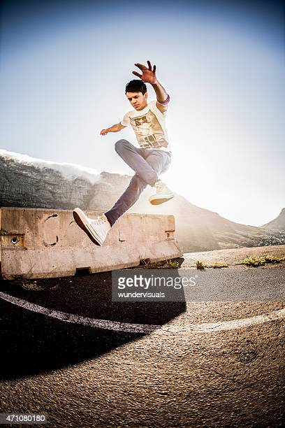 Hispanic b-boy practicing his parkour and breakdancing moves