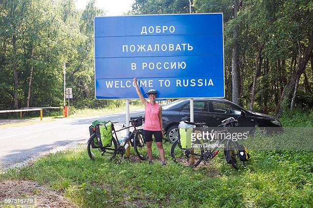 hispanic biker cheering at russian border - leap of faith stock photos and pictures