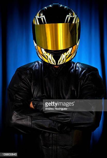 Hispanic biker in leather and reflective helmet