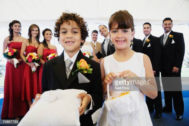 Hispanic boy and girl as ring bearer and flower girl