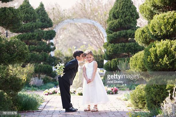 Hispanic boy and girl dressed for wedding