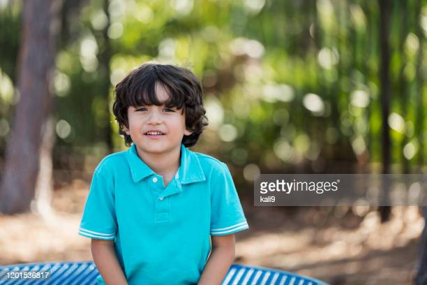 hispanic boy at the park - black hair stock pictures, royalty-free photos & images