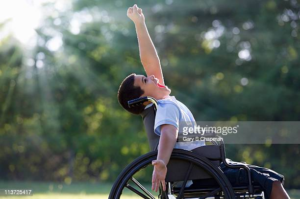 Hispanic boy in wheelchair