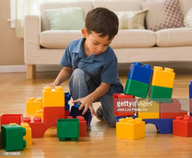 Hispanic boy playing with building blocks