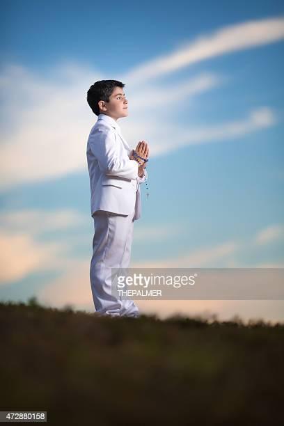 Hispanic boy praying