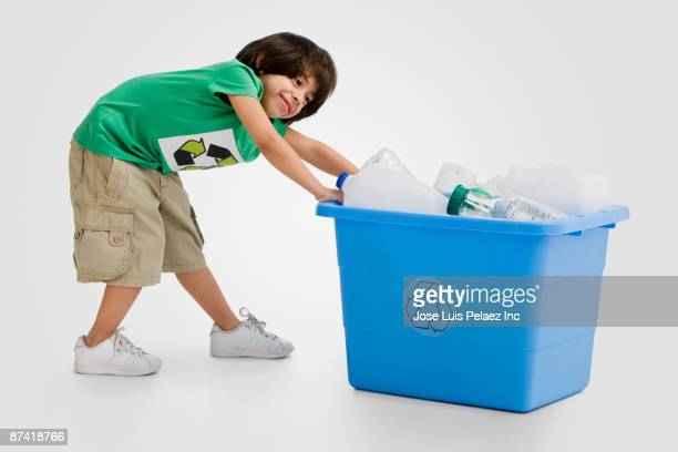 hispanic boy pulling recycling bin - dragging stock pictures, royalty-free photos & images