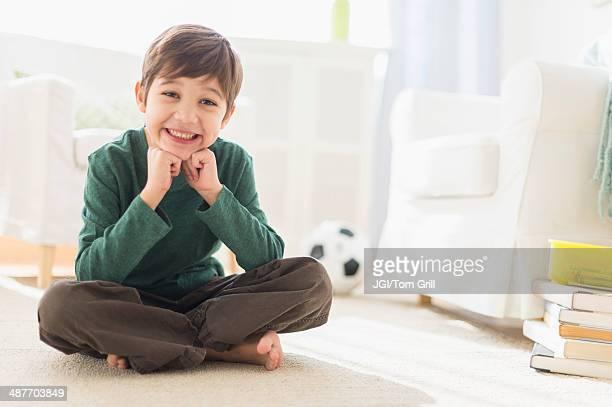 Hispanic boy smiling in living room