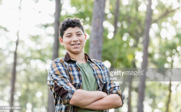 hispanic boy wearing plaid shirt - only boys stock pictures, royalty-free photos & images