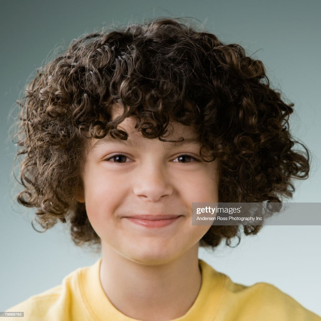 hispanic boy with curly hair stock photo - getty images
