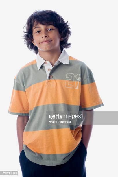 Hispanic boy with hands in pockets