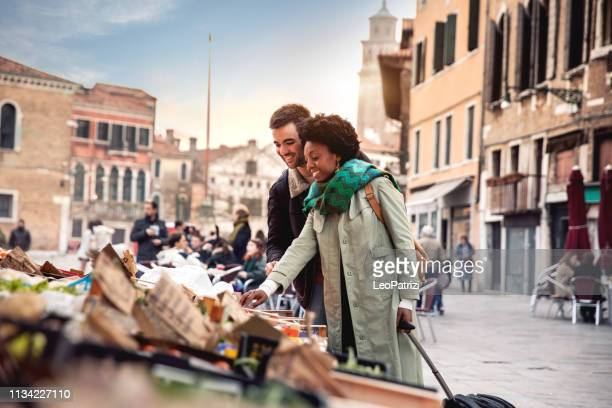 hispanic brazilian couple enjoying an holiday vacation in venice - italy - europe stock pictures, royalty-free photos & images