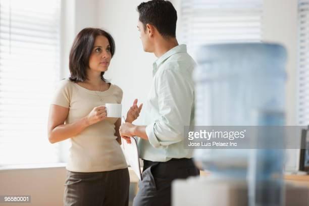 Hispanic business people talking together