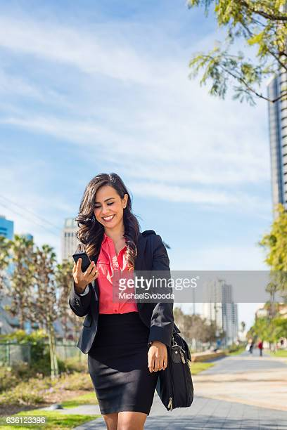 hispanic business women walking downtown san diego - mexican business women stock photos and pictures