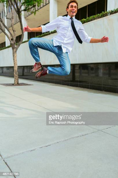 Hispanic businessman clicking his heels