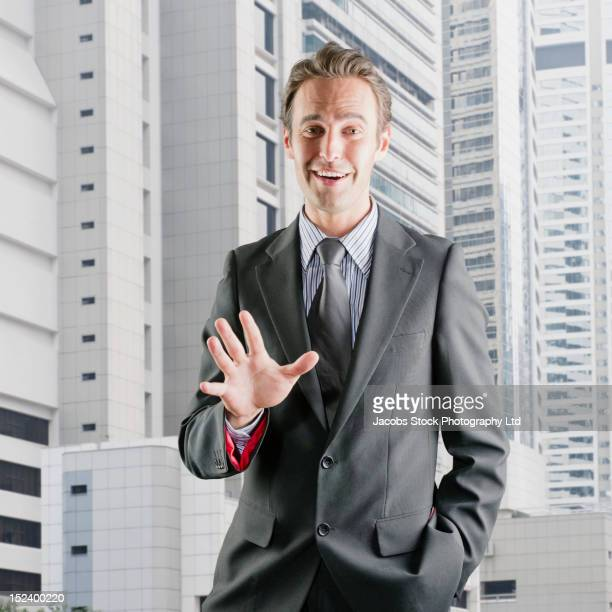 Hispanic businessman standing outdoors