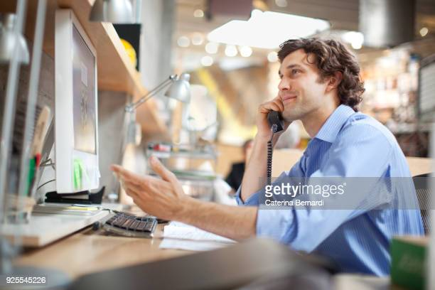 Hispanic businessman talking on telephone
