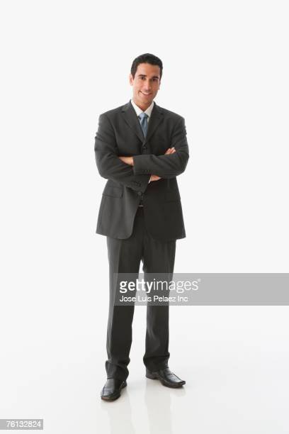Hispanic businessman with arms crossed