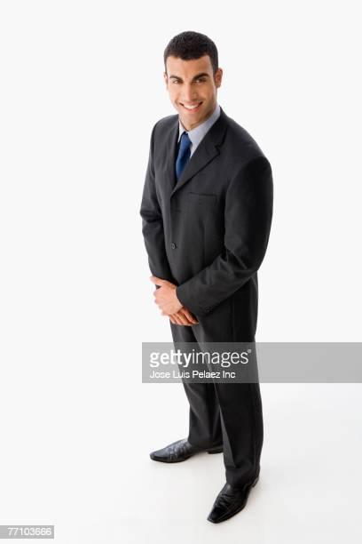 Hispanic businessman with hand clasped