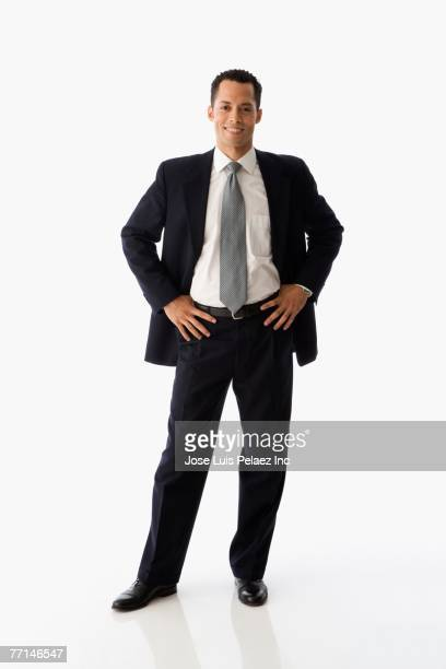 hispanic businessman with hands on hips - handen op de heupen stockfoto's en -beelden