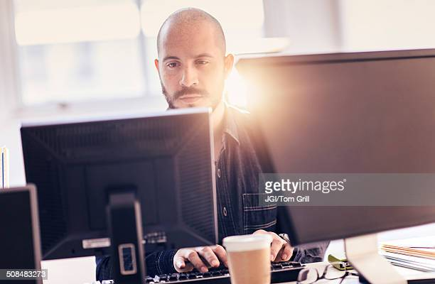 Hispanic businessman working at desk